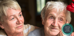 Elderly mother and daughter image
